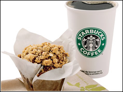 Starbucks' new, healthier breakfast choices which focus on portability and beverage pairings include an apple bran muffin with a cup of coffee.
