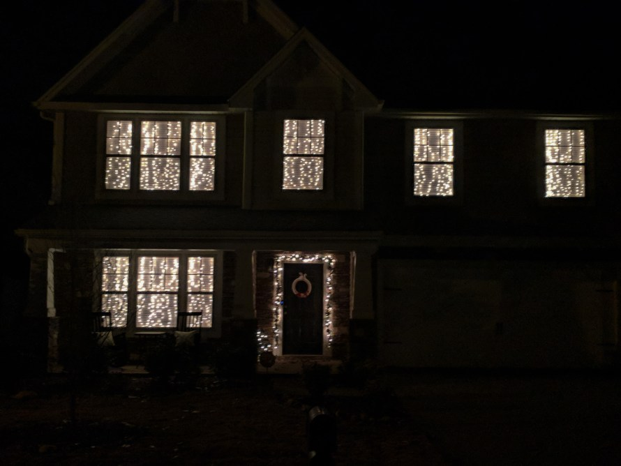 Christmas lights on the inside of windows so you don't have to climb a ladder. Genius!