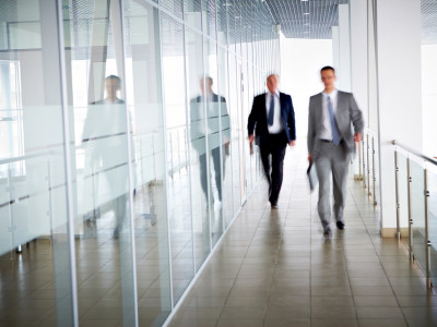 fast paced business men in suits picture