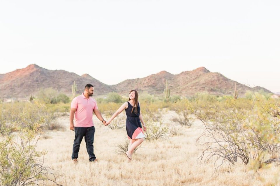 flirty engagement session in the desert