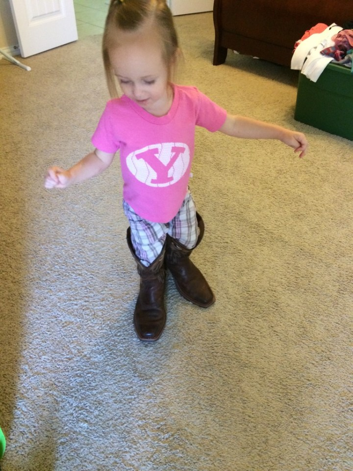 Eliza wearing daddy's boots. She had one on backwards before this and walked halfway across the room before she realized.
