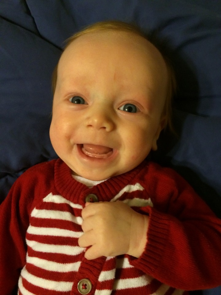 We finally got a cute picture of James's cute gummy smile. We think his teeth may come through any day so this may be our last look at this. .. :(