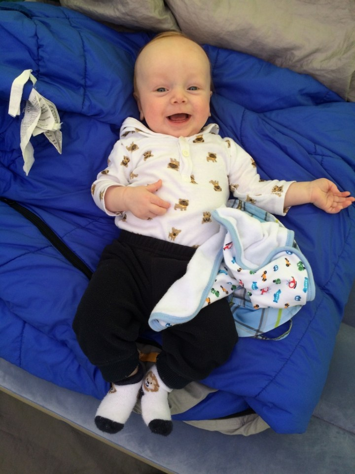 James being happy on mommy's sleeping bag