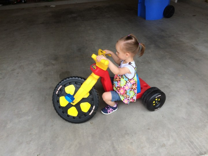 We introduced her to her big-wheel this week. She loved it even though she's still a bit small for it.