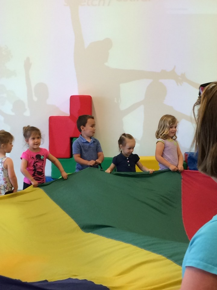 Eliza joined right in playing with the parachute