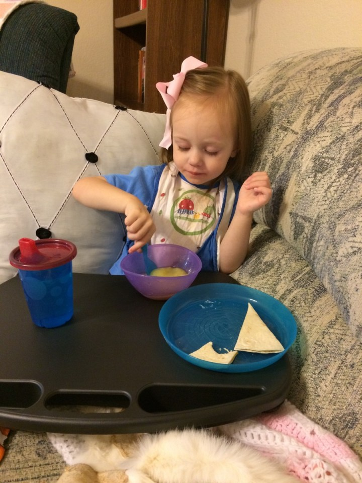 Eliza got to eat on the couch after she crashed early before eating dinner after we went swimming.