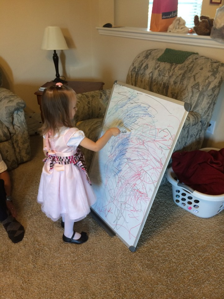 Eliza coloring on the white board