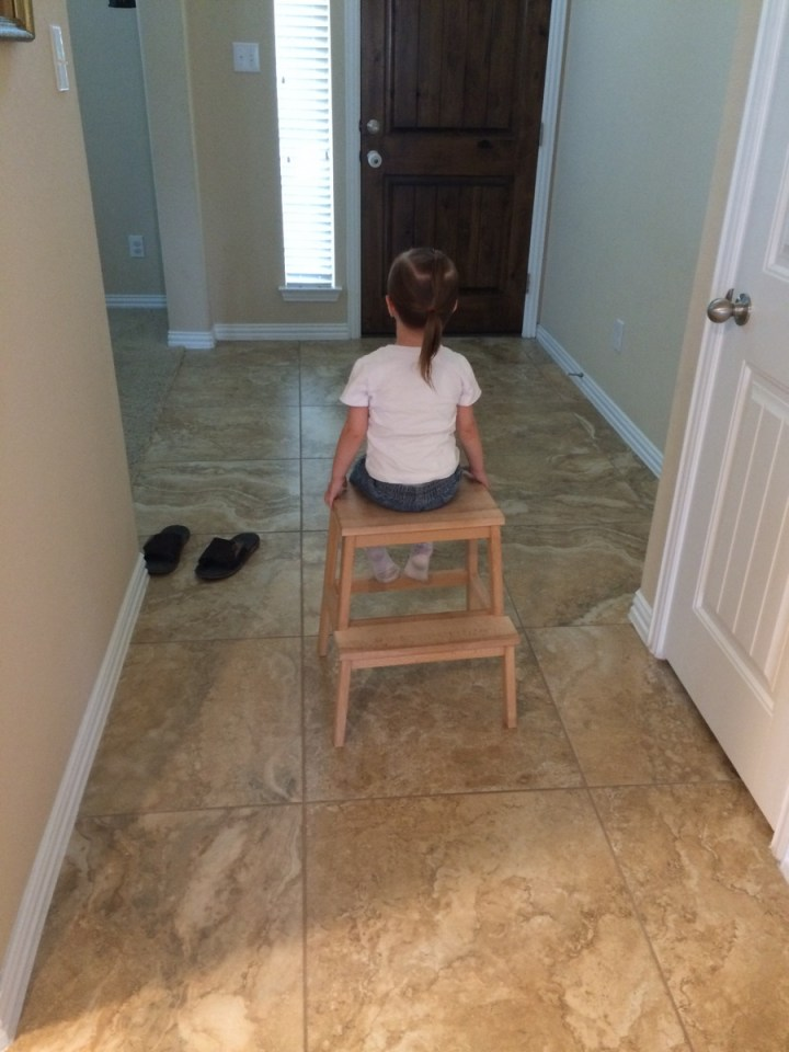 She is definitely a 2-year-old girl. She's getting comfortable on the time out stool these days.