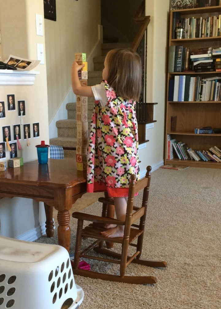 We have a sheet from the doctor that says that a 2-year-old should be able to stack three blocks . . . can you say overachiever!?