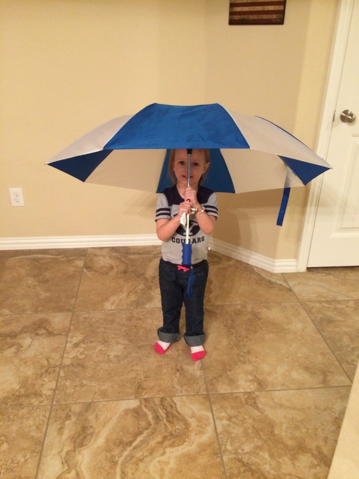 Eliza loved using the umbrella in (and out of) the rain.
