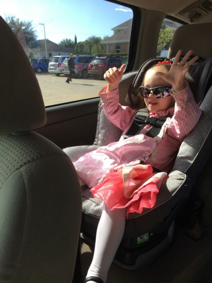 "On the way to regional conference Eliza was wearing daddy's sunglasses and mommy asked her to do ""thumbs up."""
