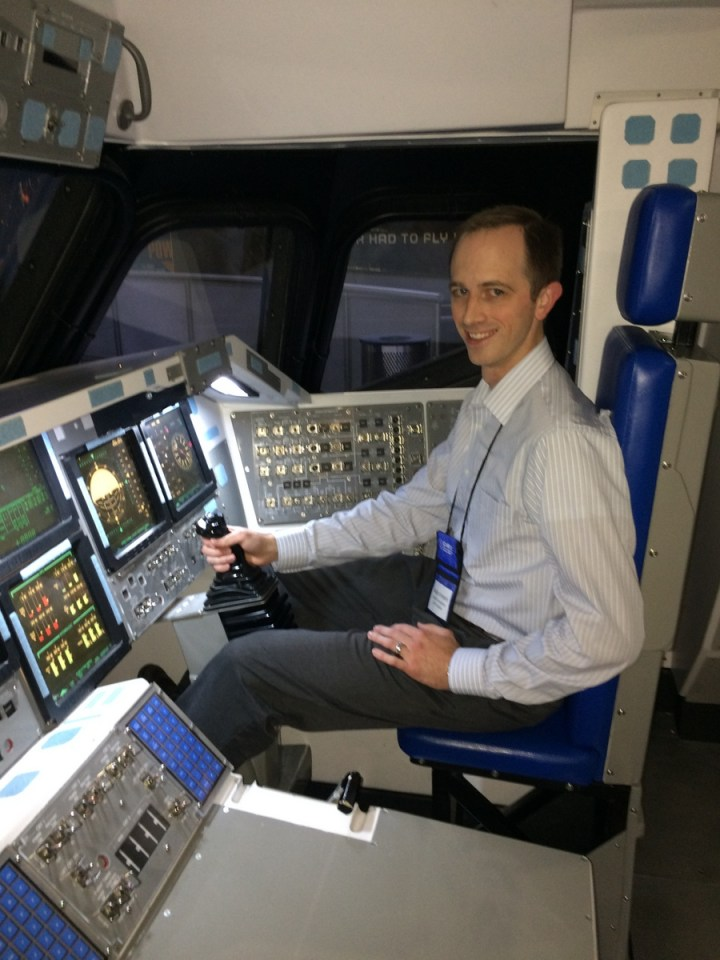 Sitting in the space shuttle cockpit mockup at the Kennedy Space Center Visitor complex. We had dinner here as part of the CHREC conference and we had the whole place to ourselves! It was awesome!