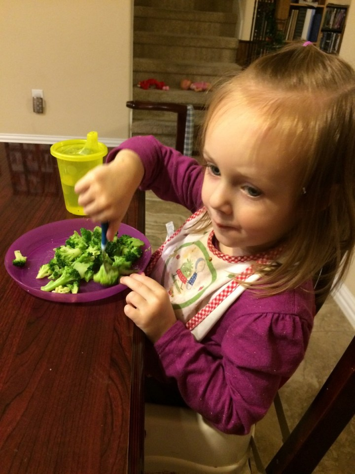 Eliza with her pile of vegetables for dinner.