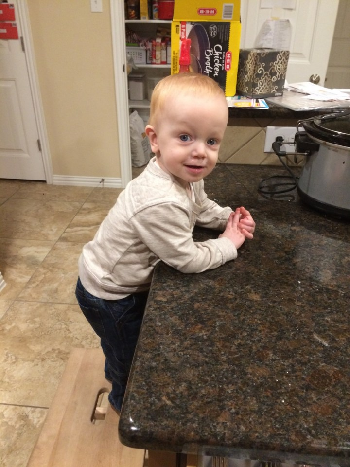 James likes to climb up on the stool and see what is going on on the counter.
