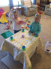 Eliza and her friend having a tea party.