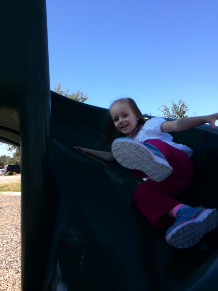 Eliza loves slides even more than swinging!