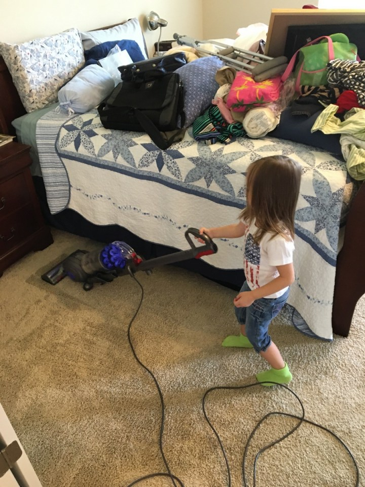 Eliza wanted to help vacuum the floor so she got to do part of mommy and daddy's room.