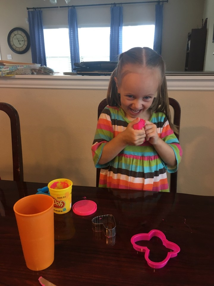 Playing with playdoh on her birthday