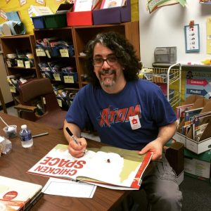 Signing books after the author visit