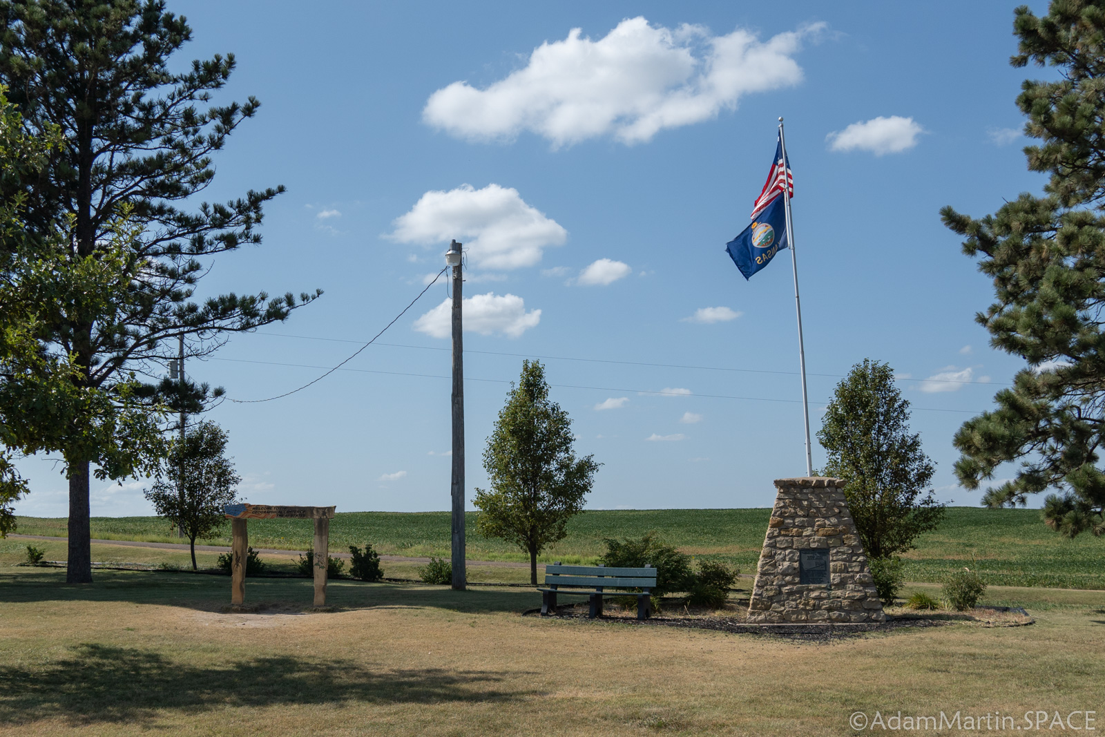 Geographic Center of the Contiguous United States - Marker monument with flagpole on top