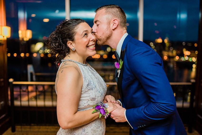 first look at holiday inn rooftop in Arlington Virginia by Washington DC Wedding Photographer Adam Mason