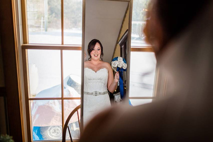 Bride looking in the mirror on wedding day at Barn at Kline's Mill wedding by Washington DC Wedding Photographer Adam Mason