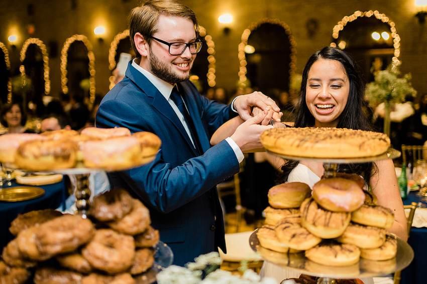 donut wedding cake and wedding ring shot by Washington DC Wedding Photographer Adam Mason
