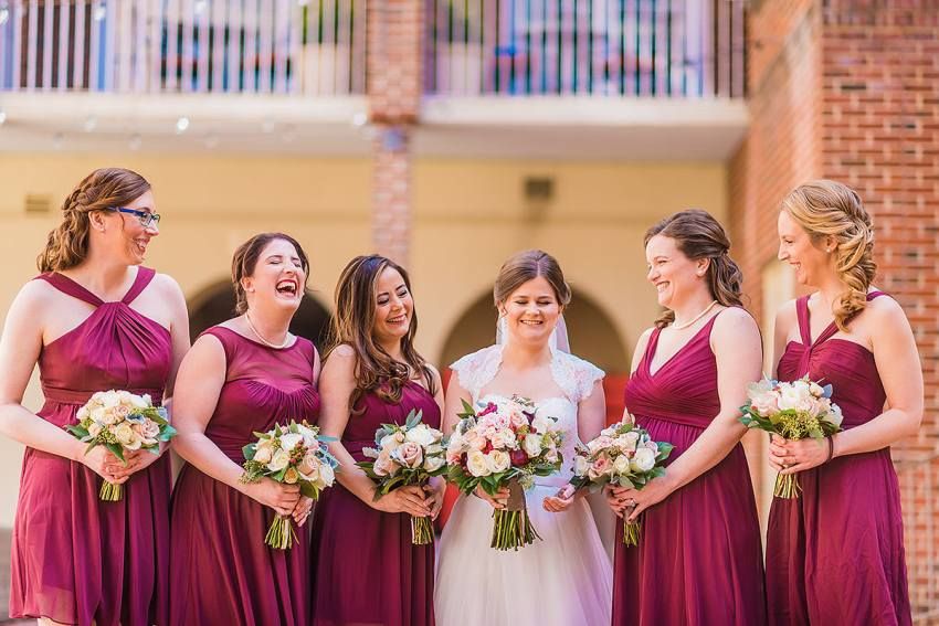 bridesmaids laughing at Alexandrian Hotel Wedding by Washington DC Wedding Photographer Adam Mason