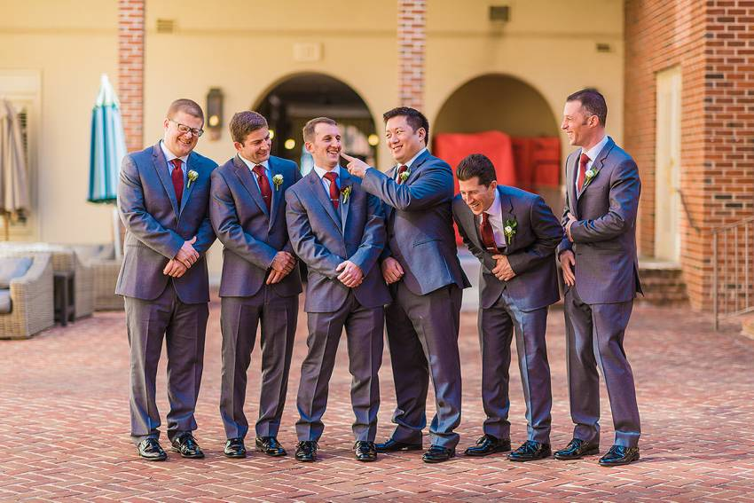 groomsmen having fun in old town alexandria wedding by Washington DC Wedding Photographer Adam Mason