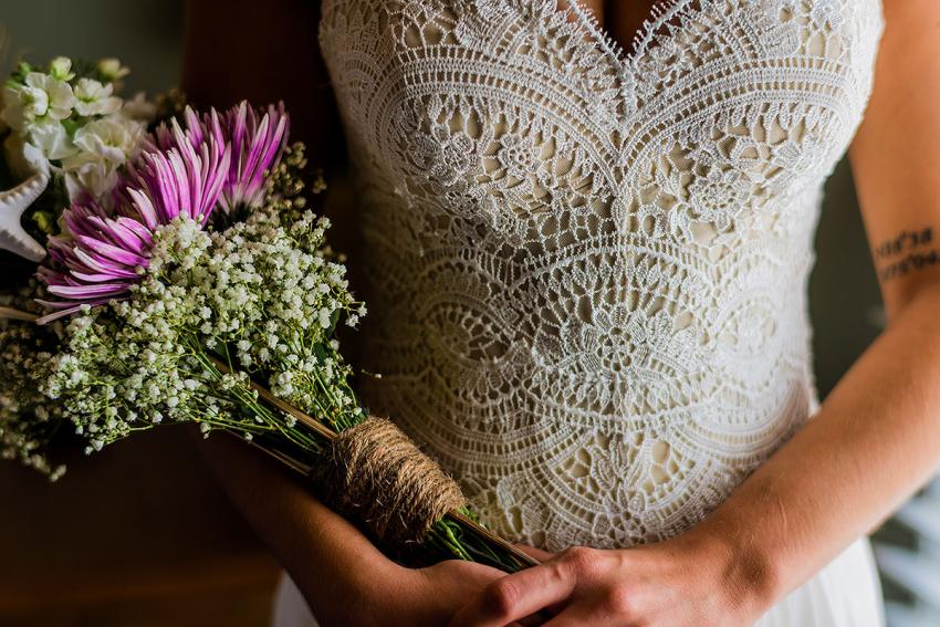handmade bouquet and wedding dress at Indian River Life Saving Station Wedding by Washington DC Wedding Photographer Adam Mason