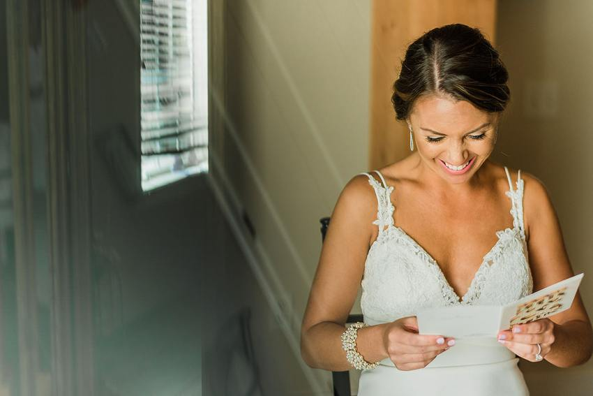 getting ready during wedding at wyndridge farm by Washington DC Wedding Photographer Adam Mason