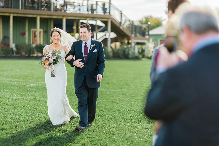 bride and father walking down the aisle at thousand acre farm wedding by Washington DC Wedding Photographer Adam Mason