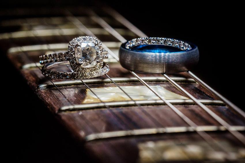 unique wedding ring photo on electric guitar by Washington DC Wedding Photographer Adam Mason