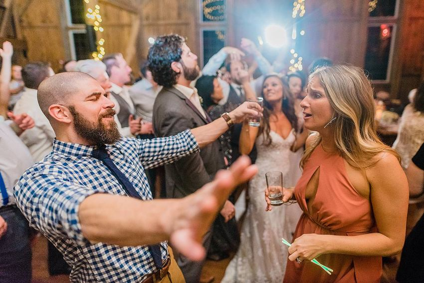 wedding guests fun reception and epic emotion by Washington DC Wedding Photographer Adam Mason