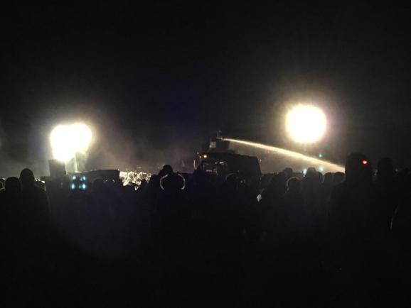 Water cannon used in 23-degree temperatures