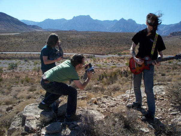 Adam W. Michaels, Adam J. Manley, and Dr. Noise film a music video out in the desert outside Las Vegas.
