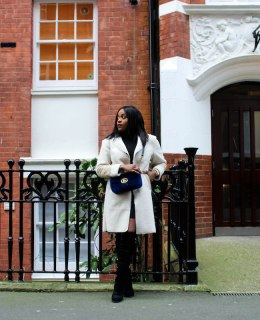 Adaora Soludo wearing teddy coat and Velvet gucci marmont bag boots