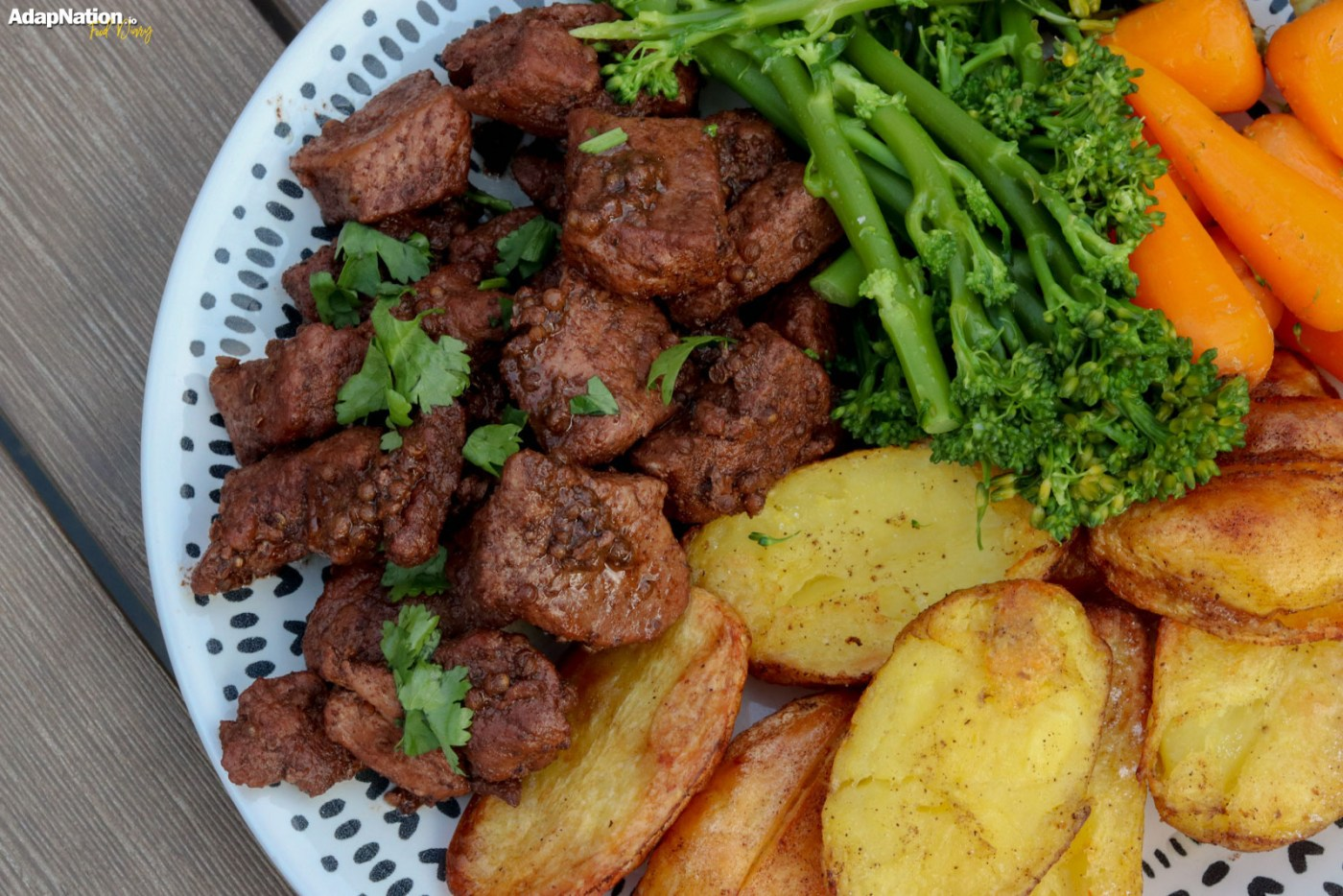 Pork Afelia with Roast Potatoes and Tender Veg