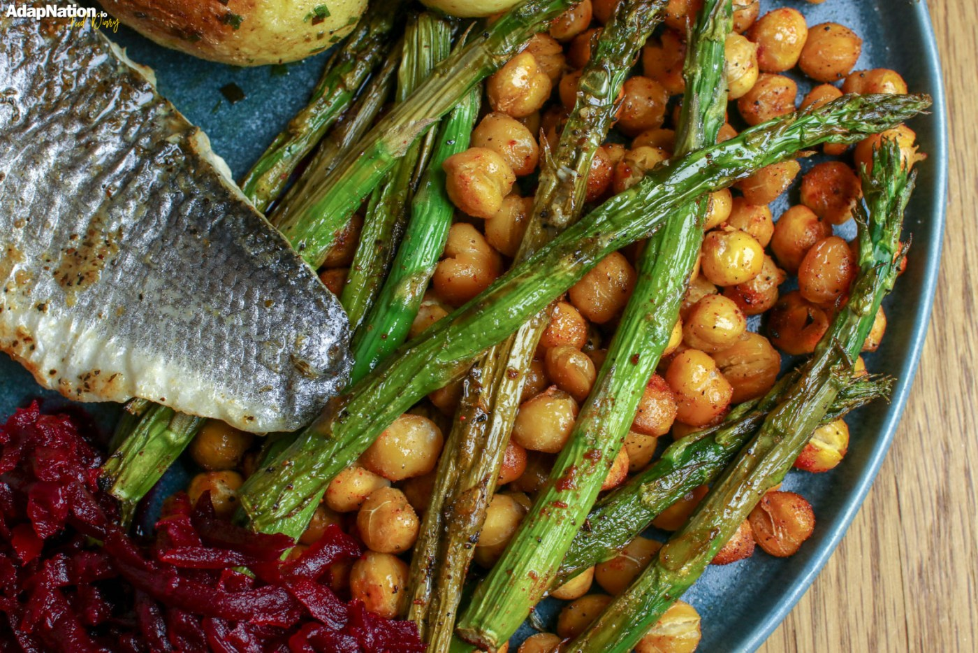 Pan Fried Sea Bass, with Roasted Chickpeas & Asparagus, Smoky Beetroot & Baby Potatoes