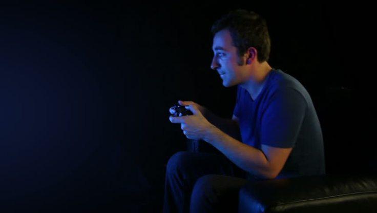 Guy playing games at night