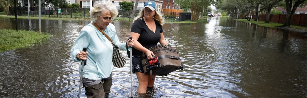Marlene Sulkers, left, is escorted by her granddaughter Rachel Sulkers as they evacuate from Rachel's residence in the aftermath of Hurricane Irma, in Jacksonville, Fla. Tuesday, Sept. 12, 2017. Marlene Sulkers came from Ft. Meyers to Jacksonville trying to get away from the storm.