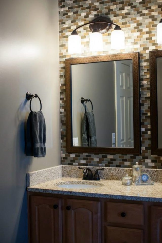 Bathroom remodel with all new fixtures, tile, and lighting.
