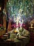 A fantasy table setting in a fantasy garden.
