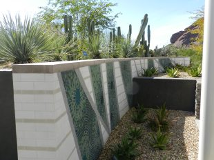 The hardscapes — walls and paths, lighting and signs —add to the botanical garden's good looks.