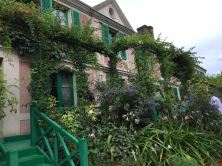 Claude Monet's house seems practically overtaken by the flowers of the garden.