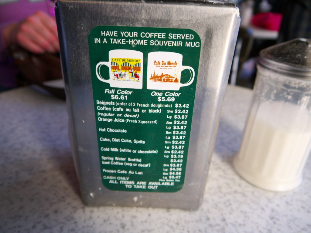 menu is located on the napkin dispenser