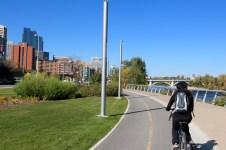 Amanda biking along the Bow River Pathway in Calgary.