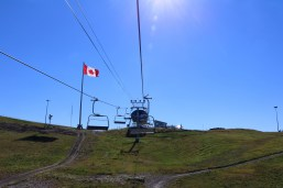 Riding up the chair lift to the top of the luge track at Canada Olympic Park, Calgary.