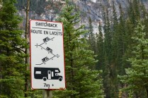 Switchback sign for the steep and winding road towards Takakkaw Falls in Yoho National Park, BC.