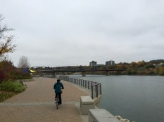 Amanda biking the The Meewasin Trail in Saskatoon, Saskatchewan.